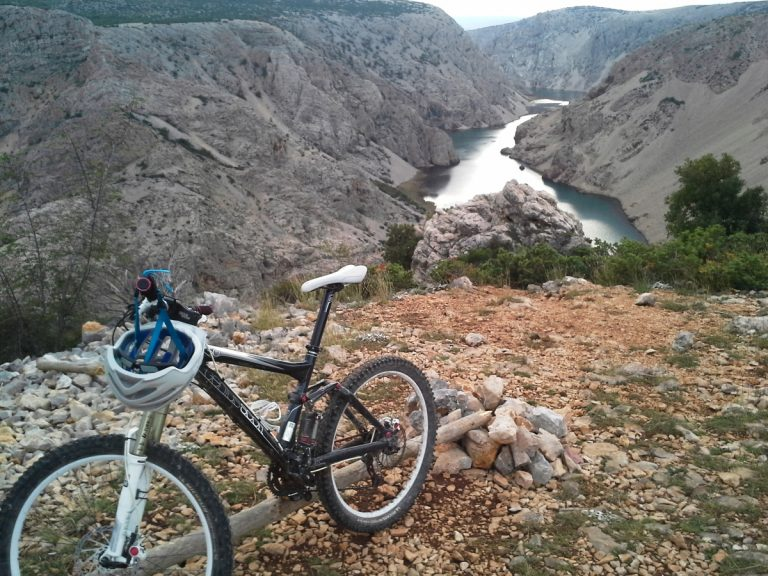 Mountain bike on the top of the hill. A view on the river.